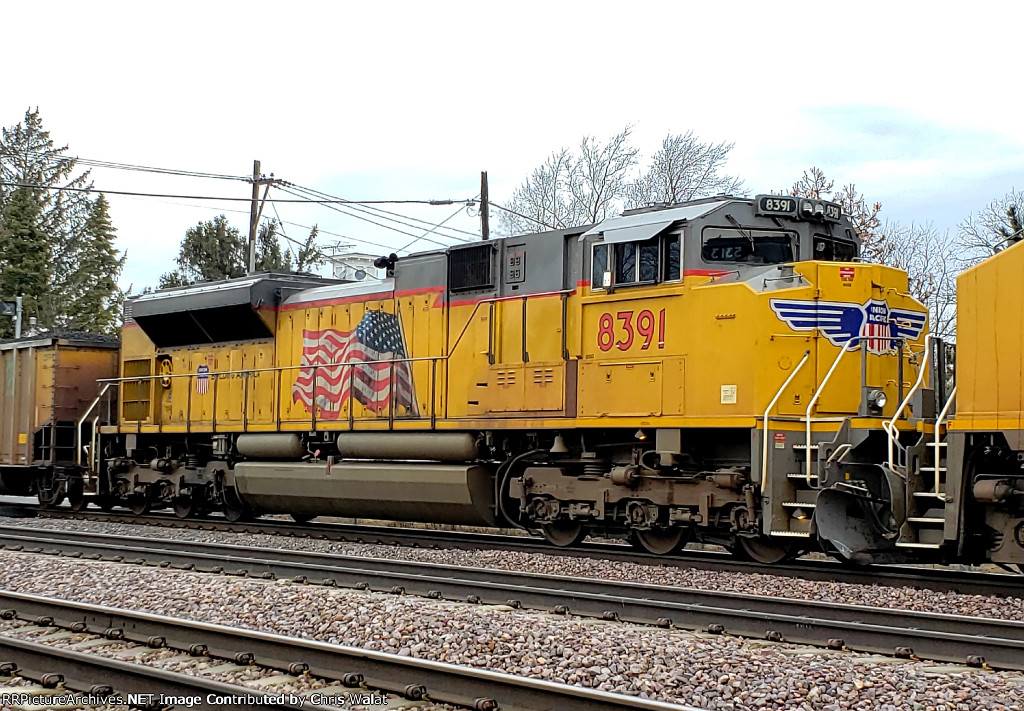 UP 8391 trails 3rd out on a east bound coal train